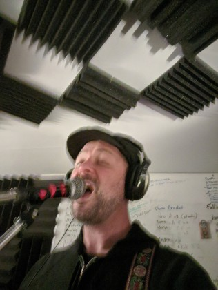 Ryan Carroll (Ten Million Lights) recording guitar and vocals for new record.